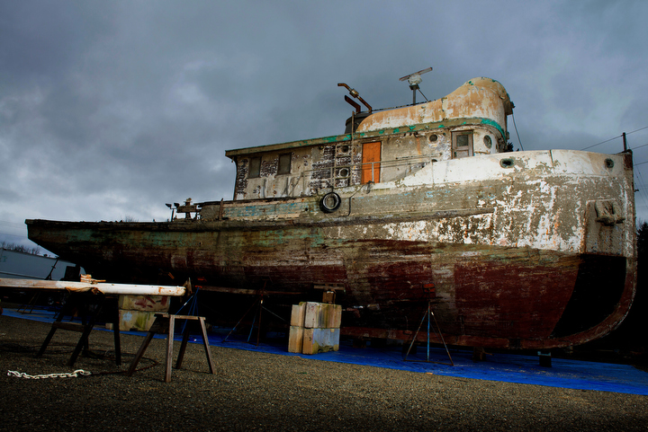 """A view of the Western Flyer ship once owned by  the author John Steinbeck, and now by John Gregg. After many failed attempts, the craft is being restored by Michael York at a dry dock in Port Townsend, Washington. In 1940, Steinbeck and a small crew navigated the Western Flyer on a successful, yet sometimes ill-fated marine specimen collection expedition along the Gulf of California. The adventures served as inspiration for Steinbeck's prized non-fiction book, """"The Log from Sea of Cortez."""" Photo by Daniel Berman for Seattle Weekly."""